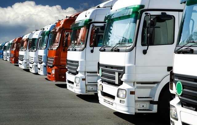 A line of trucks in the car park